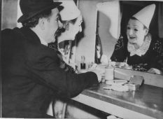 French clowns, the Cairolis Brothers, in their box at the Palladium theatre in London. Last glance in the mirror before performing for the royal family. 306-NT-483-14.
