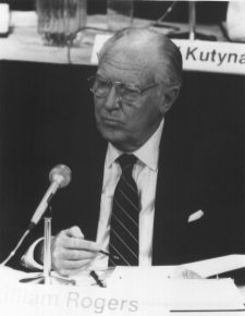 255-CB-86-H-273: Chairman of the Presidential Commission on the Space Shuttle Challenger, William P. Rogers, Listens to Testimony at an Open Hearing at the Kennedy Space Center.