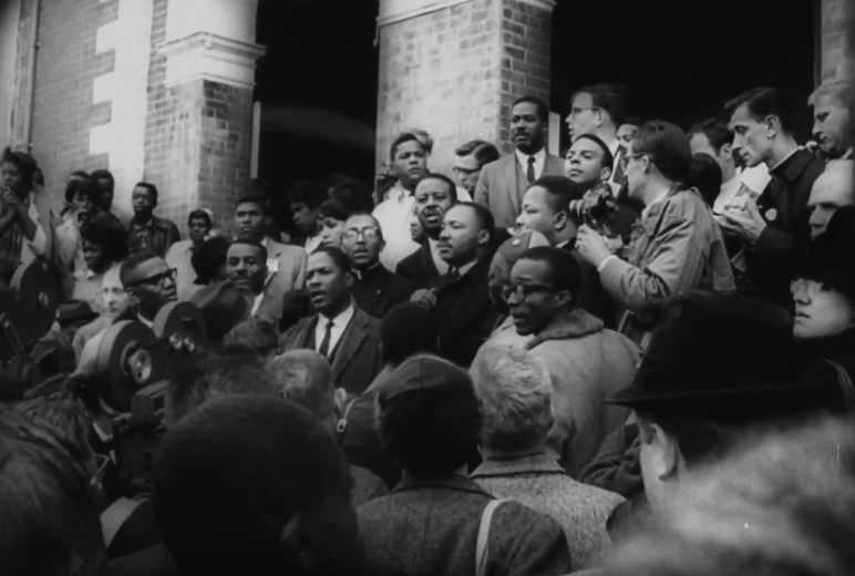 Dr. King with crowd outside Brown Chapel A.M.E. Church.