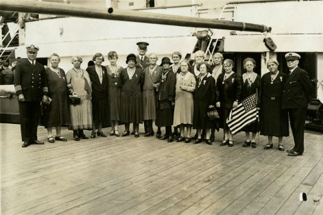 """Original Caption: """"A group of mothers and widows, members of Party """"T,"""" photographed aboard the REPUBLIC with Colonel Williams just before sailing from New York."""" Local ID: 92-GS-2-118."""