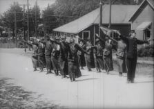 The women learn semaphore flag signaling.