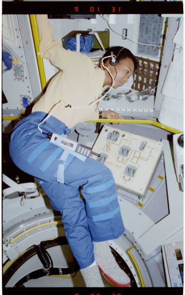 """""""Photographic documentation of Mission Specialist (MS) Mae Jemison near Rack 1 in Spacelab-Japan (SL-J)"""" - Mae Jemison is the first African-American female astronaut. In 1992, she flew into space aboard the Endeavour, becoming the first African-American woman in space."""