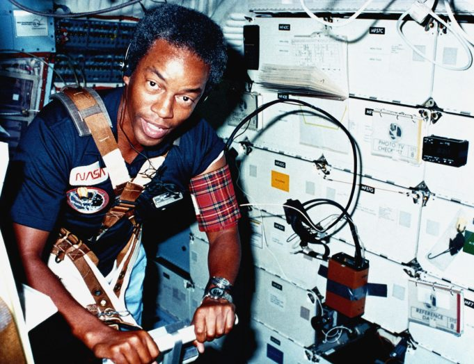 """""""Astronaut Guion S. Bluford, mission specialist, walks on a treadmill exerciser during a medical test aboard the space shuttle orbiter Challenger (STS-8)."""" - As a mission specialist aboard the space shuttle 'Challenger' in 1983, Guion S. Bluford became the first African American to travel into space."""