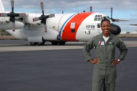 """""""U.S. Coast Guard LT. j.g. Jeanine McIntosh, Pilot, the first female African-American to successfully complete flight training, stands in front of a U.S. Coast Guard HC-130H Hercules patrol aircraft on Jan. 2, 2006, that she will pilot on service missions throughout the Pacific region, while stationed at Coast Guard Air Station Barbers Point, Oahu, Hawaii. (U.S. Coast Guard photo by Public Affairs SPECIALIST 2nd Class Jennifer Johnson) (Released)."""" Date Taken: January 2006 (Local ID: 330-CFD-DD-SD-07-24603)"""