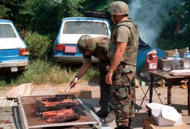 """(Local Identifier: 330-CFD-DM-SD-03-07042) """"Marines from Kilo Company, 3rd Battalion, 8th Marine Regiment enjoy a 4th of July BBQ at their command post in Gnjilane, Kosovo. They are part of the Marines and sailors of the 26th Marine Expeditionary Unit (MEU) that are helping to enforce the implementation of the military technical agreement and to provide peace and stability to Kosovo during Operation JOINT GUARDIAN."""""""