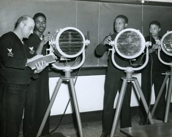 """""""Blinker"""" operation instruction being given to sailors in training as destroyer-escort crew at NTS Norfolk, VA. Left to right: Ernest V. Alderman, Lorenzo Dufu, Julius Holmes, and William M. Jones (Local ID: 80-G-214544)"""