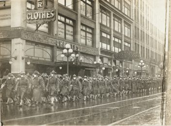The 39th Regiment on its way to France marched through the streets of Seattle, Washington. Everyone provided with a mask made by the Seattle Chapter of the Red Cross. Local Identifier: 165-WW-269B-8