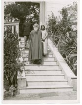 """""""Mr. Rabindranath Tagore with Captain S. W. Chaudhari, his Physician, and Mrs. Pratima Tagore, his Daughter-in-Law at the Exit of their Cap Martin Property"""" (306-NT-351E-12)"""