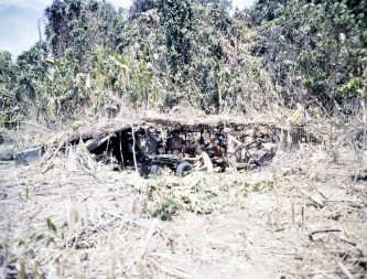 "Photo ID: 127-N-68167. Original caption: ""Marine artillery battery firing on distant Japanese target. Bougainville."" Photographer: Sgt. V.M. Hanks. Date: December 25th, 1943."