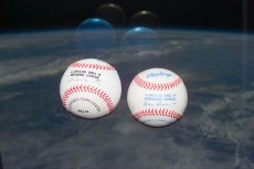 """255-STS-S73E5137.jpg: """"Baseballs from the American and National Leagues float in the flight deck to commemorate the World Series between the Atlanta Braves and Cleveland Indians. Views were taken with an electronic still camera."""""""