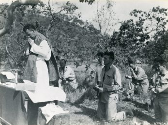 """Photo ID: 342-FH-3A-32915-67763AC. Original caption: """"Men of the 38th Bomb Group attend a Catholic mass held on Christmas Day, 1942, in New Guinea."""" Date: December 25th, 1942"""