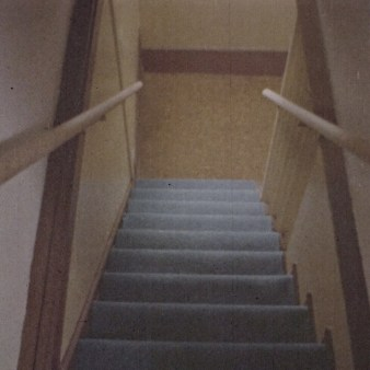 """Well-lit, solid color stair treads in """"That Feeling of Falling"""""""
