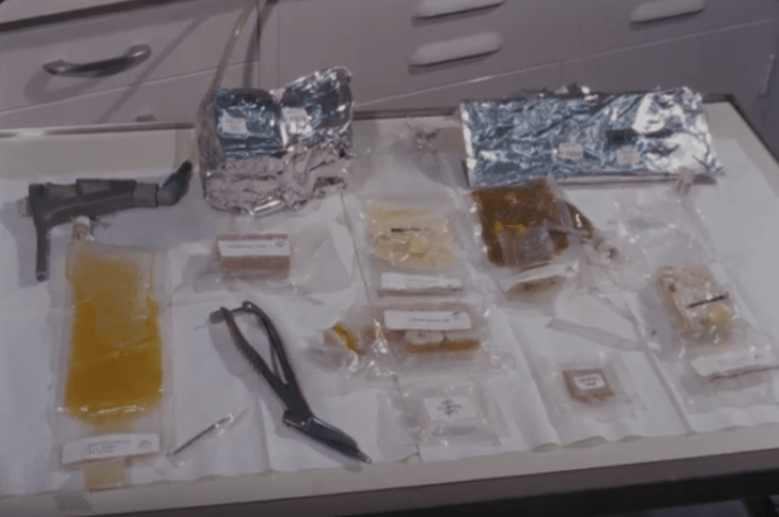 A tray holding small packages of dehydrated foods designed for the Apollo 11 mission. Also shown are tools used to rehydrate the foods for consumption.