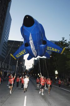 Several employees from Key Bank present a Blue Angles balloon at the Torchlight Parade, a highlight of the 55th annual SEAFAIR summer festival, Seattles month-long traditional summer festival, including parades, amateur athletics, air shows and boat racing. The Key Bank Air Show at SEAFAIR will feature the US Navy Blue Angles this year (2005) Local Identifier: 330-CFD-DN-SD-06-04239 (https://catalog.archives.gov/id/6668480)