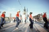 Crewmen observe female guests as they perform in a square dance on the after deck of the guided missile cruiser USS LEAHY (CG-16) during the Seattle Sea Fair 1982. Visible in the background are the twin Standard-MR SAM (88) missiles on a Mark 26 Mod launcher. Local Identifier: 330-CFD-DN-ST-83-01281 (https://catalog.archives.gov/id/6371851)