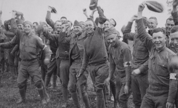 Men of the 6th Marine Regiment celebrating and waving after playing a game of baseball.