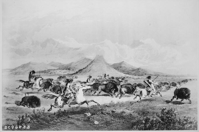 111-SC-96033 Blackfoot Indians Chasing Buffalo, Three Buttes, Montana. https://catalog.archives.gov/id/531080