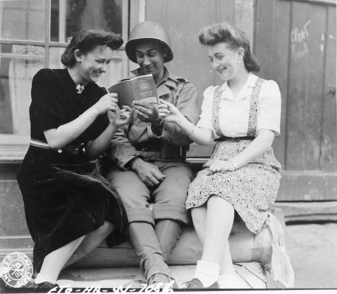 World War II Solider Reading with Two Women