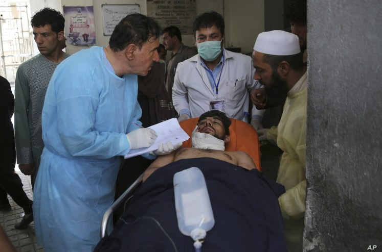 A wounded man receives treatment at a hospital after an explosion in Kabul, Afghanistan, Wednesday, Aug. 7, 2019. A suicide car bomber targeted the police headquarters in a minority Shiite neighborhood in western Kabul on Wednesday, setting off a…