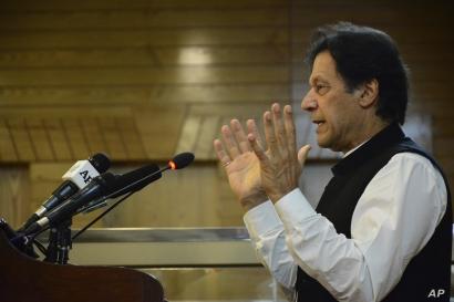 Pakistani Prime Minister Imran Khan addresses Kashmir's Legislative Assembly on the occasion of Pakistan's Independence Day, in Muzaffarabad, capital of Pakistani Kashmir, Aug. 14, 2019.