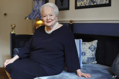 FILE - U.S. actress Olivia de Havilland poses during an interview, in Paris, June 18, 2016. The two-time Oscar-winning actress is suing FX Networks and producer Ryan Murphy's company, alleging unauthorized and false use of her name and invasion of pr