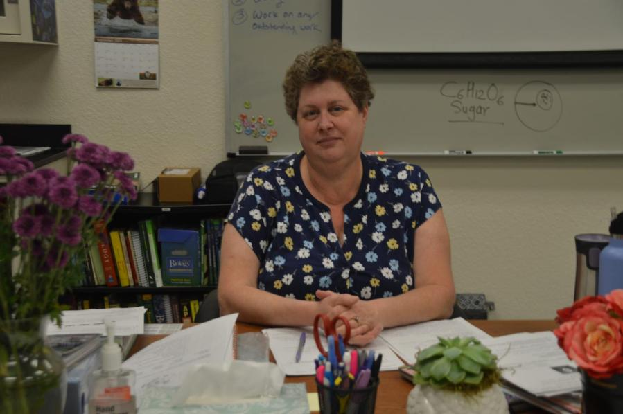 Bailey poses at her desk in MIT, where she teaches biology.