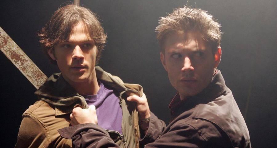 """In """"Supernatural's"""" pilot episode, Sam Winchester (Jared Padalecki) and Dean Winchester (Jensen Ackles) watch as Dean's car is turned on by a ghost."""