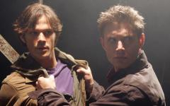 In Supernatural's pilot episode, Sam Winchester (Jared Padalecki) and Dean Winchester (Jensen Ackles) watch as Dean's car is turned on by a ghost.
