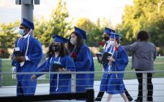 Graduates exit the stadium to reunite with their families with a rose and a letter graduates wrote for their parents. Right to left: Graduates Rohan Manian, Isabella Bronner, Emily Bravo, Ishan Madan and Kylie Malone.