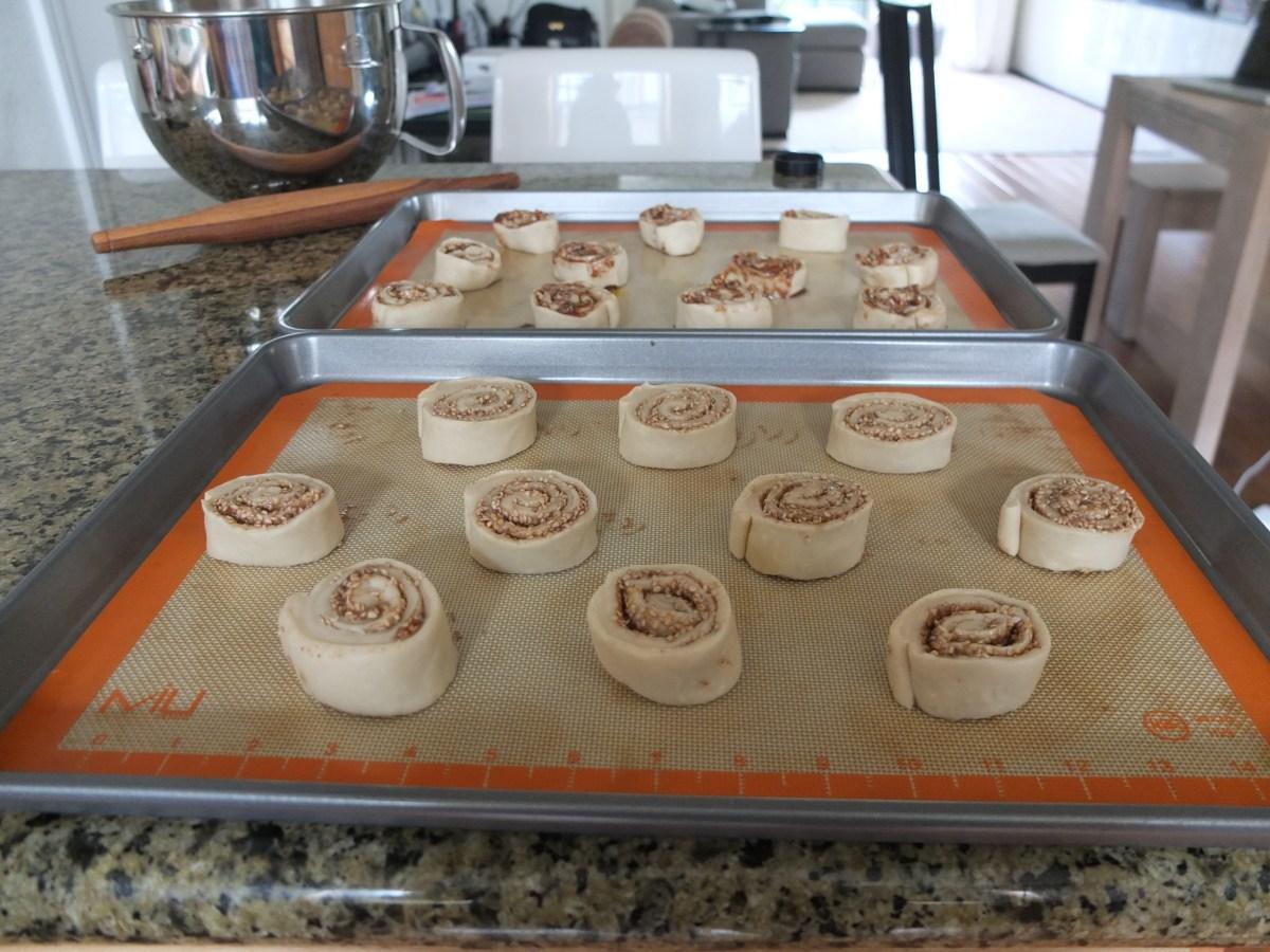 Sesame and Pecan Schnecken Rolls with Orange Glaze on tray before baking
