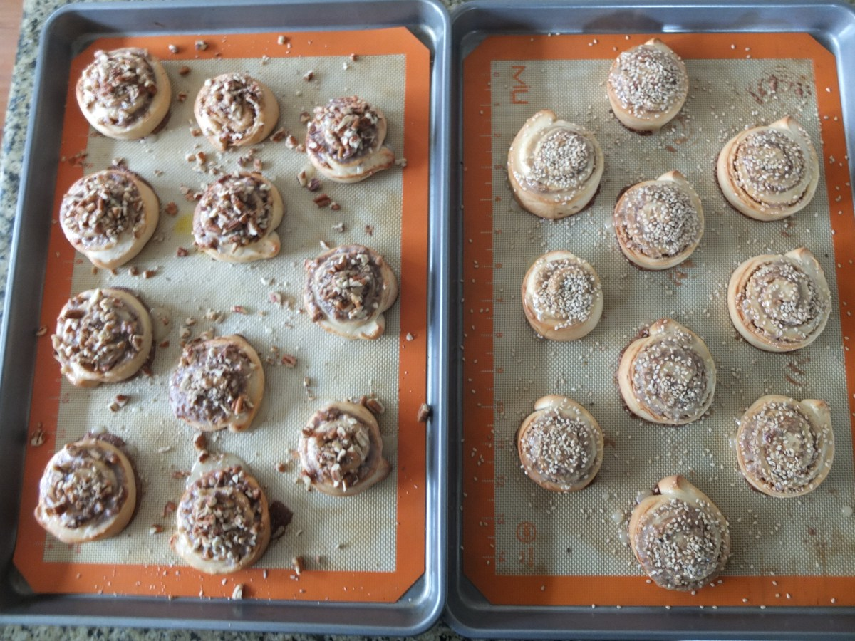 Finished Sesame and Pecan Schnecken Rolls with Orange Glaze