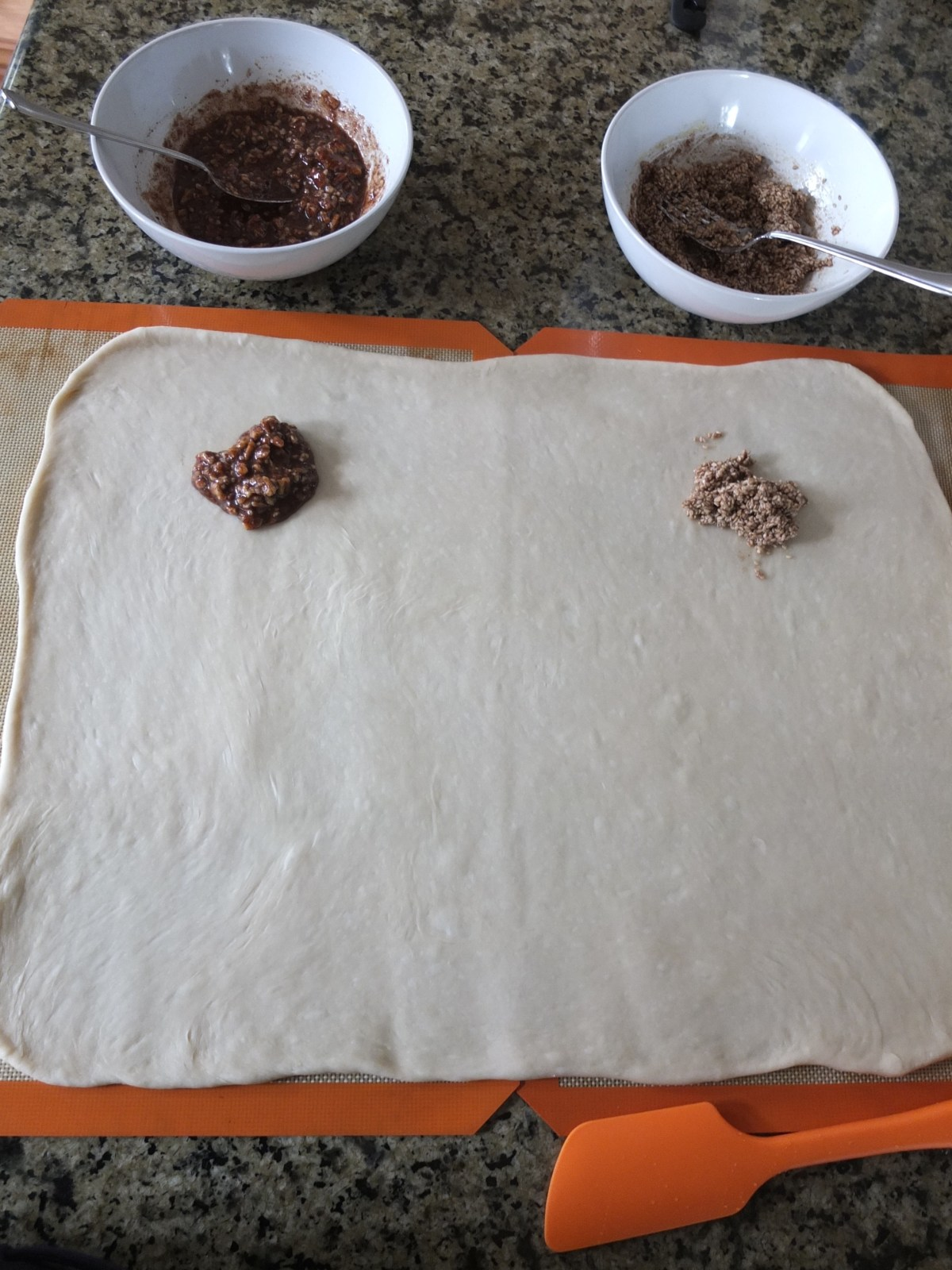 Rolled out dough before fillings for Sesame and Pecan Schnecken Rolls with Orange Glaze