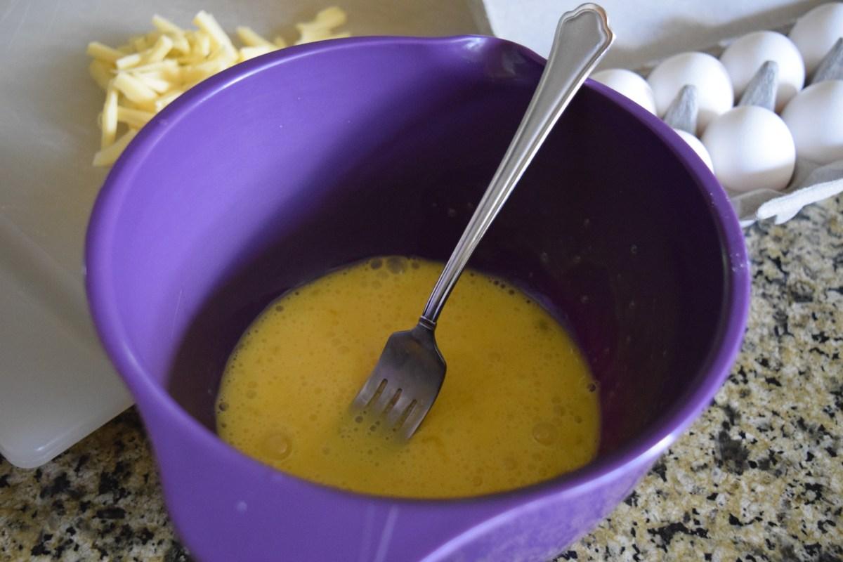 Eggs beaten in mixing bowl