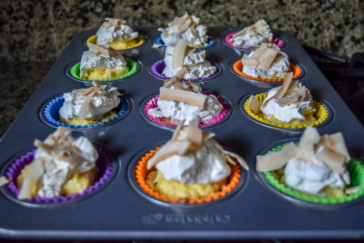 Finished Coconut Cream Pie Bites topped with toasted coconut flakes in tray
