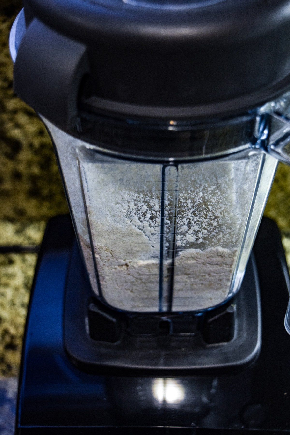 Flour in Vitamix dry grains container vertical