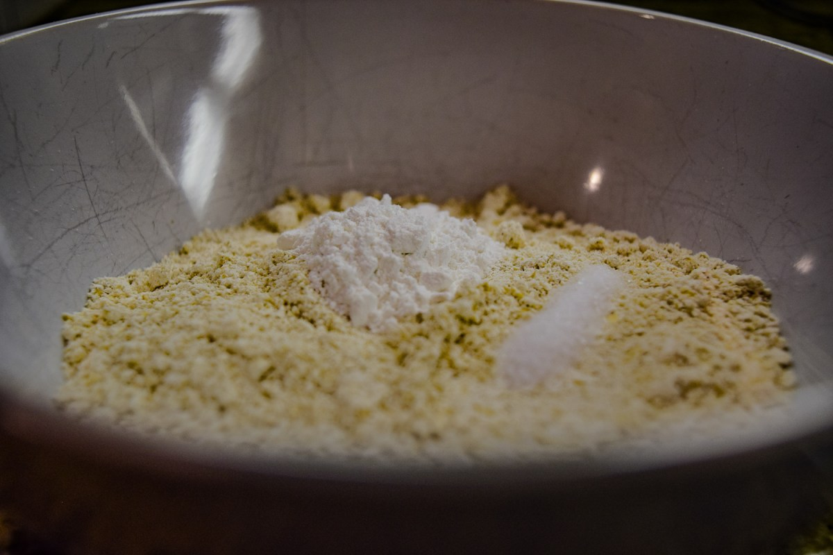 Dry ingredients for peanut butter cookie crust, including oat flour, baking powder, and salt