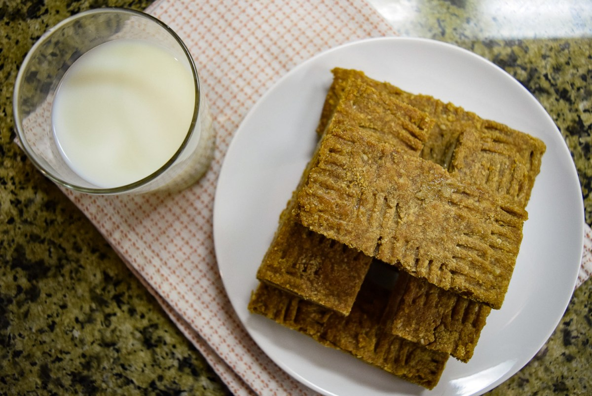 Peanut Butter + Banana Ice Cream Sandwiches with glass of milk from top