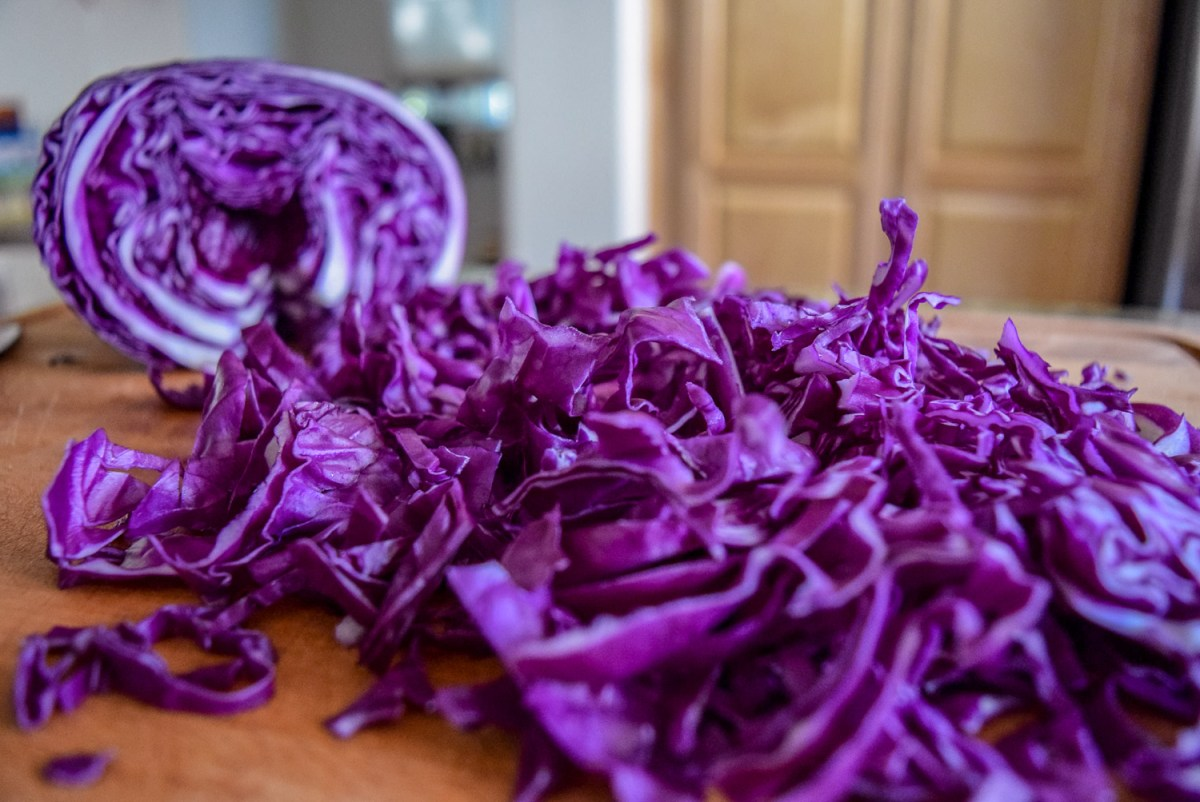 Thinly sliced red cabbage for Sunshine Spicy Mustard Tahini Cruciferous Slaw