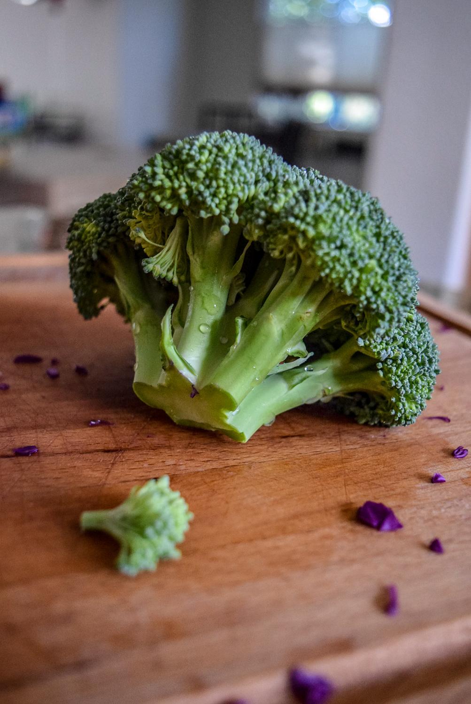 Whole broccoli head for Sunshine Spicy Mustard Tahini Cruciferous Slaw
