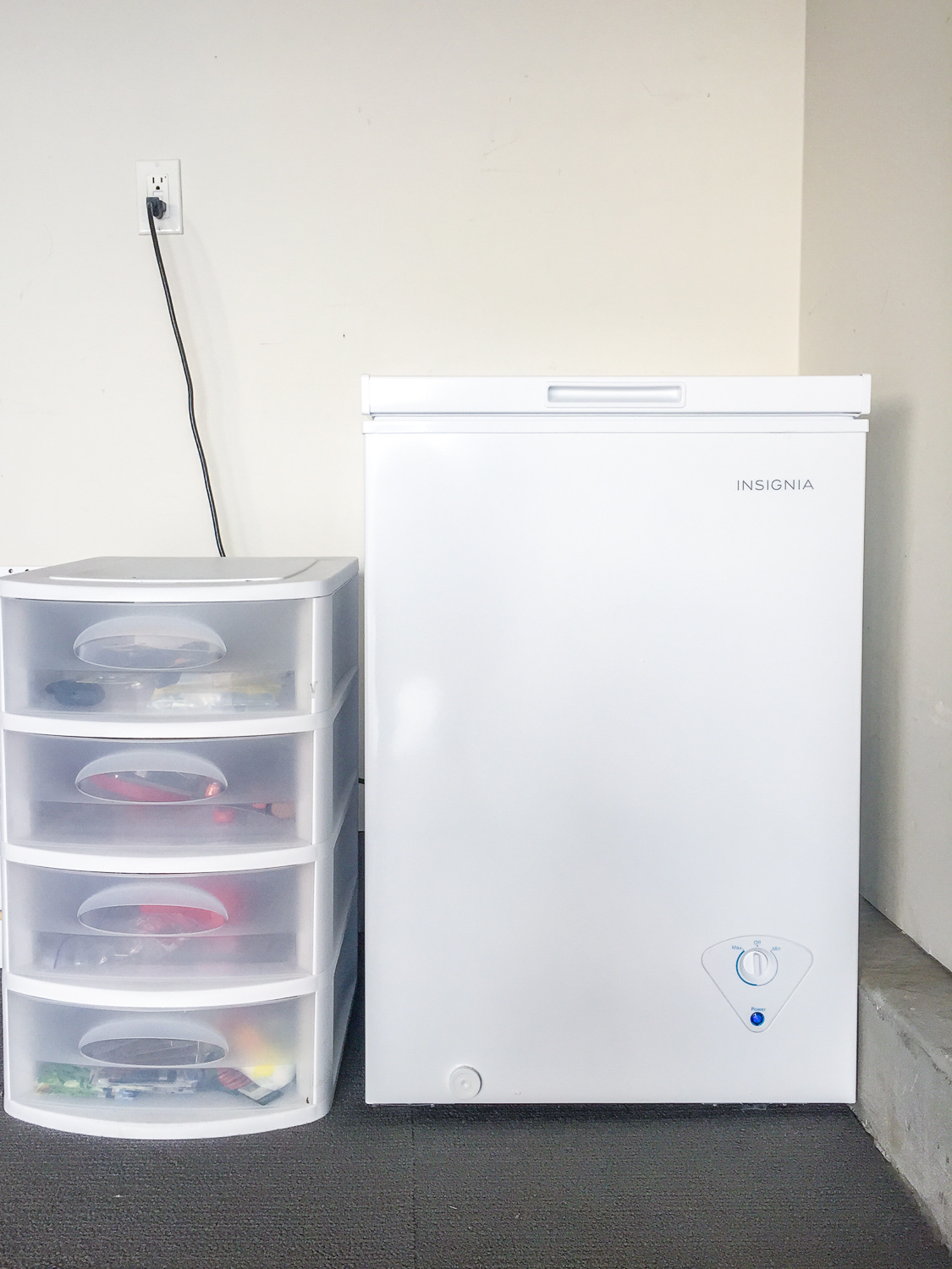 closed Insignia 3.5 Cu. Ft. Chest Freezer in Garage