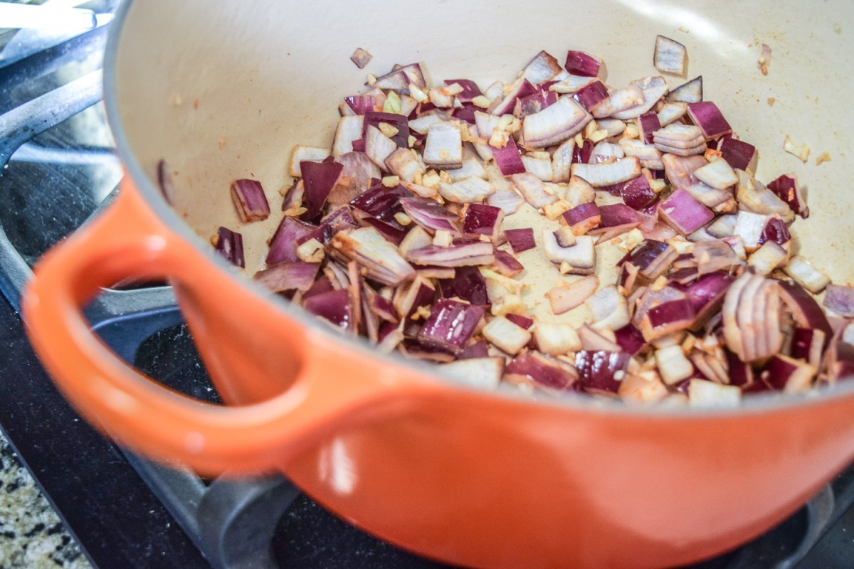 Sauteed chopped red onions and minced garlic for the Egg-White Chili Shakshuka