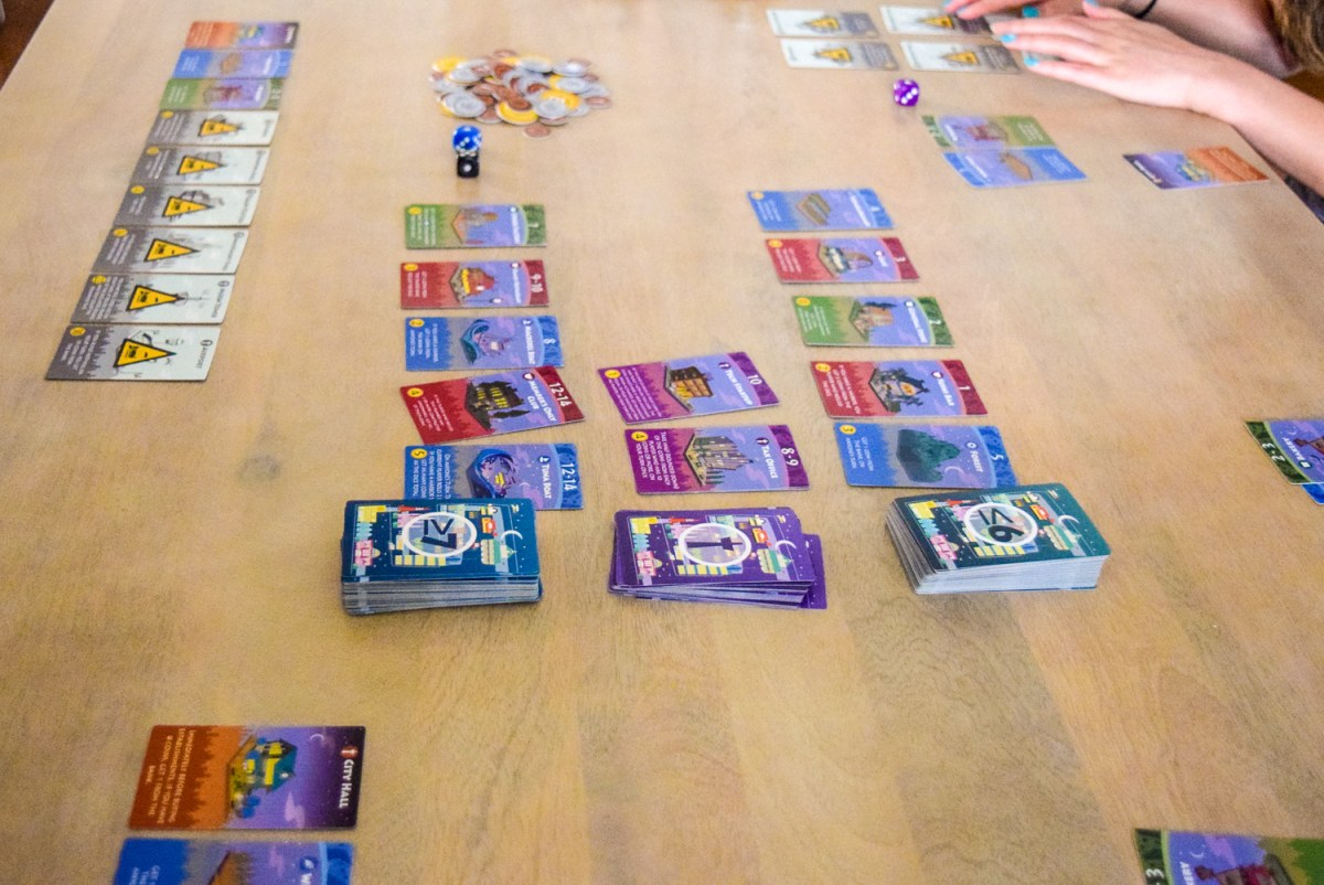 Central card stacks for playing Machi Koro: Bright Lights, Big City from side