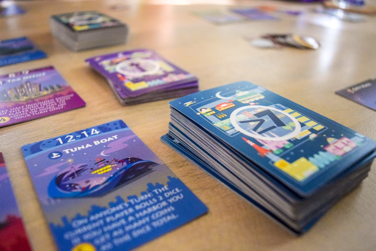 Central card stacks for playing Machi Koro: Bright Lights, Big City up close