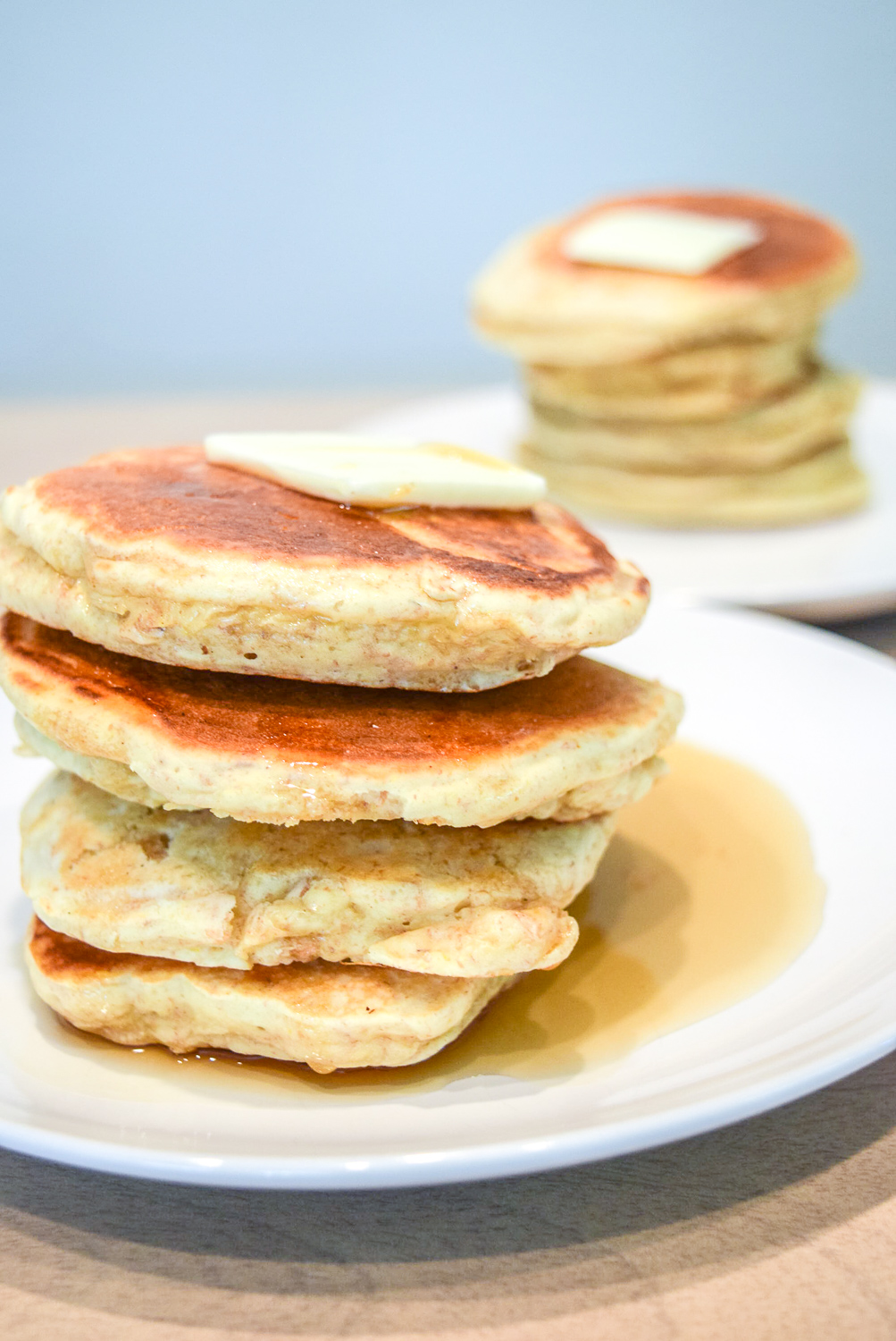 Trader Joe's Multigrain Pancake Mix stacks with butter and maple syrup from left side