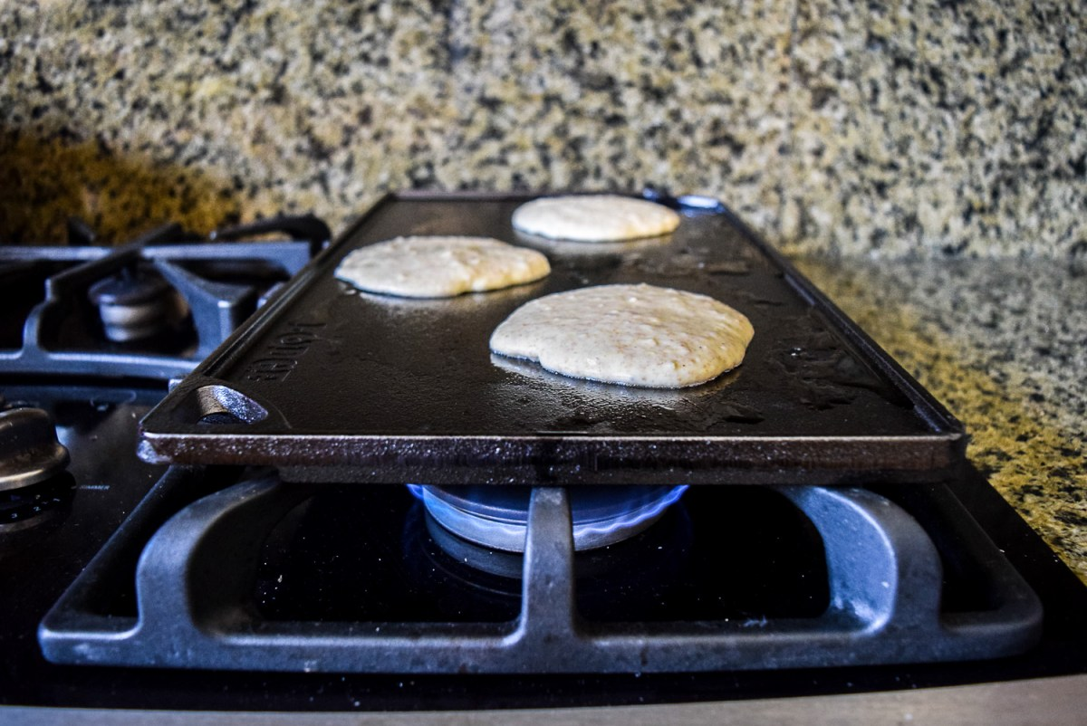 Trader Joe's Multigrain Pancake Mix batter poured onto Lodge Cast Iron Reversible Griddle/Grill