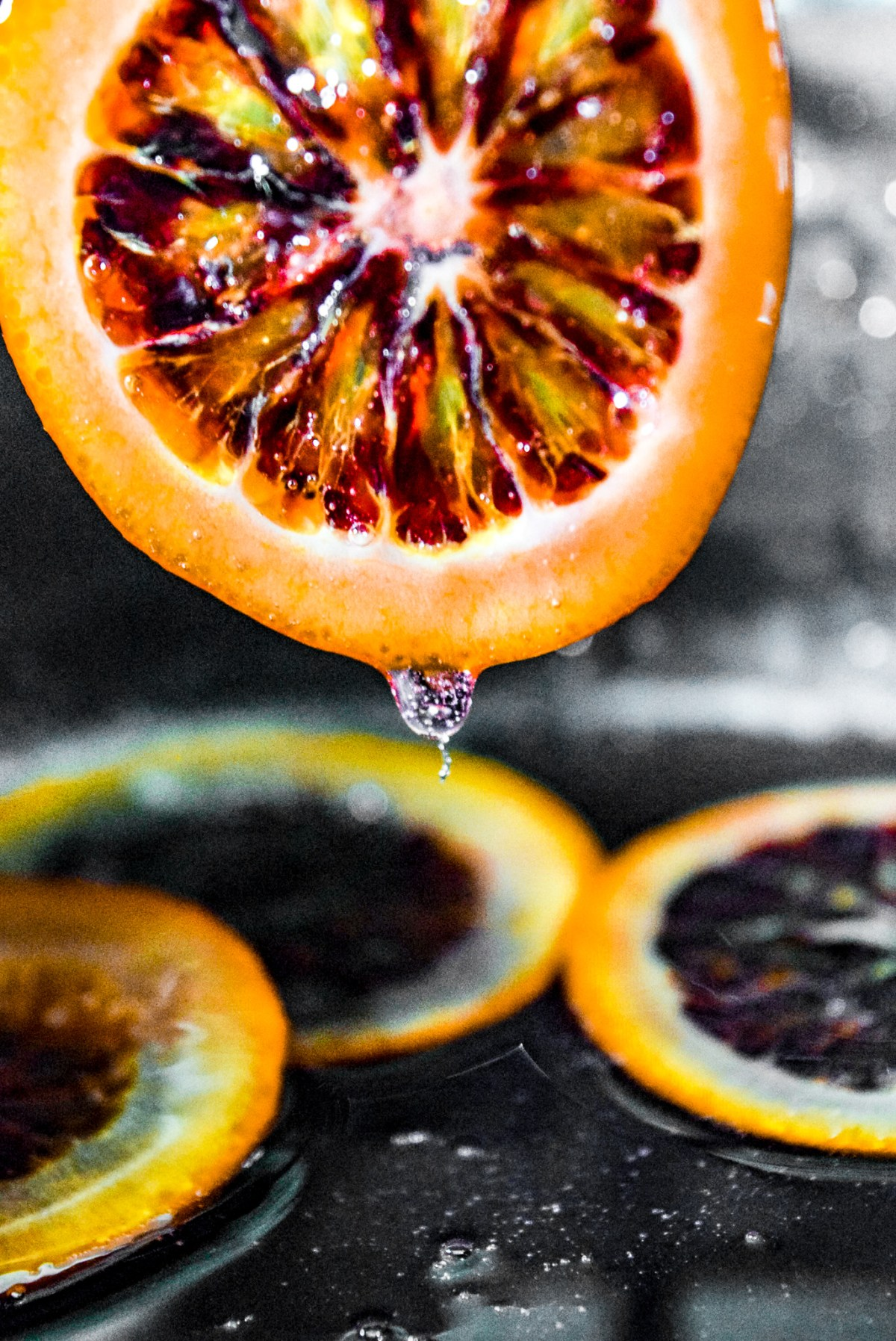 Removing blood orange slice from sugar water after candying