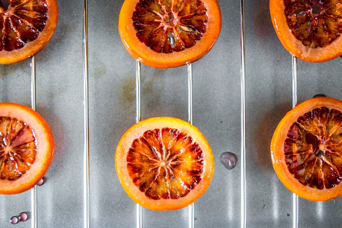 Two-Ingredient Candied Blood Orange Rounds drying and hardening after candying from top