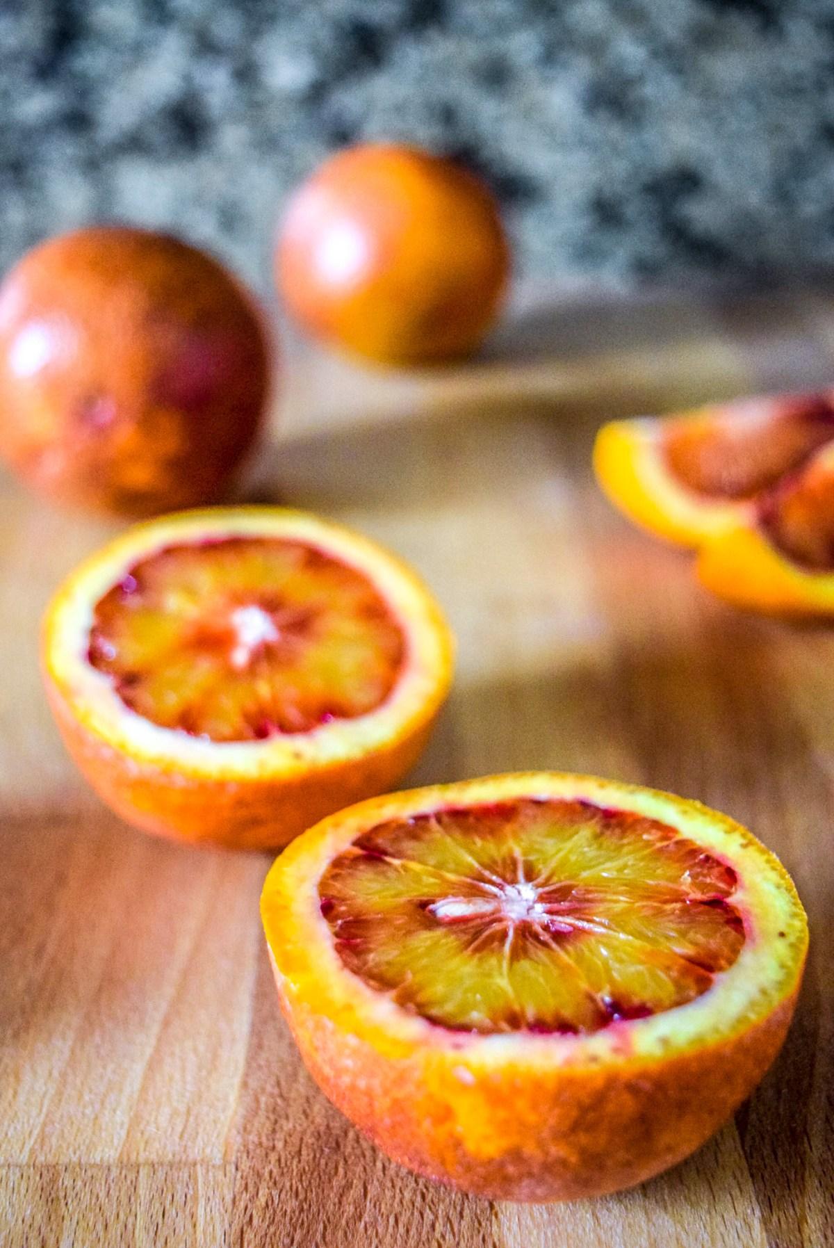 Sliced blood oranges on wooden cuttingboard