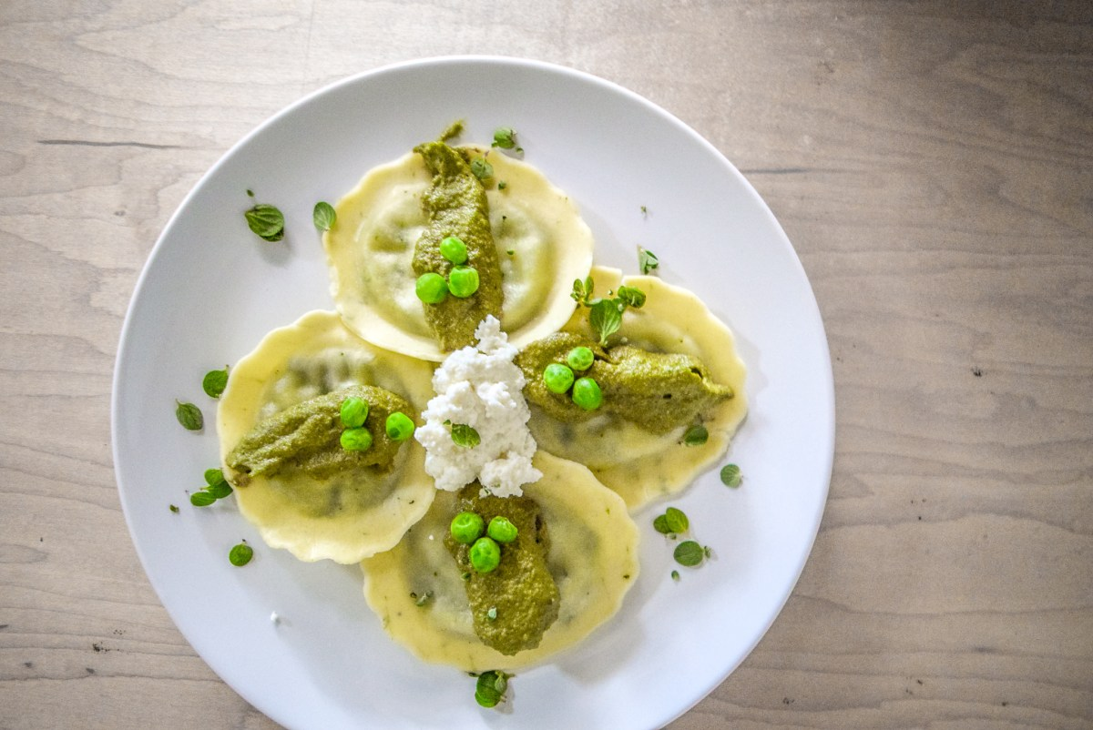 Marjoram Pea Pesto Ricotta Ravioli on plate from top horizontal