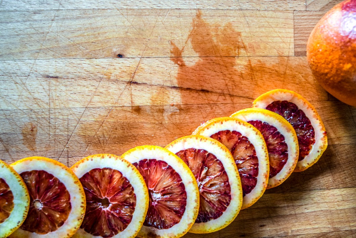 Sliced blood oranges in arc from top for blood orange syrup